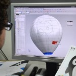 An Ultra Magic designer piece by piece constructs a technical drawing of the Penguin shaped hot air balloon.